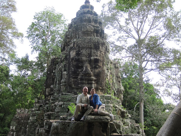 Photo of Bill and Val on the Victory Gate in Siem Reap, Cambodia.