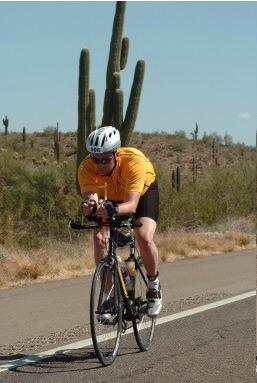 Bill passing a cactus during the Ironman in Arizona