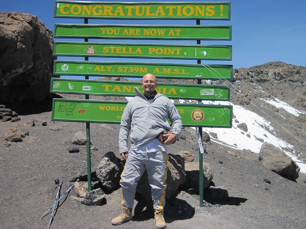 Photo of Bill at Stella Point on top of Kilimanjaro in Tanzania, Africa.